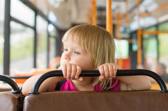 Adorable girl ride bus Stock Image