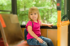 Adorable girl ride bus on passenger seat Royalty Free Stock Photos