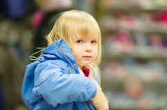 Adorable girl sit on shopping cart Royalty Free Stock Photography