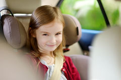 Adorable girl sitting safely in car seat Royalty Free Stock Photography