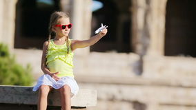 Adorable girl with small toy model airplane background Colosseum in Rome, Italy. Young girl in front of colosseum in rome, italy stock video