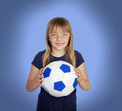 Adorable girl with a soccer ball Royalty Free Stock Photo