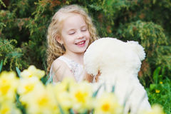 Adorable girl in the spring garden Royalty Free Stock Photos