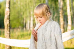Adorable girl stay covered with white blanket Royalty Free Stock Images