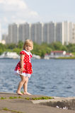 Adorable girl stay on river pier Royalty Free Stock Images