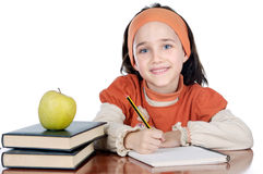 Adorable girl studying Stock Photos