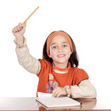 Adorable girl studying. In the school a over white background Stock Photos