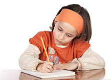 Adorable girl studying. In the school a over white background Stock Photo