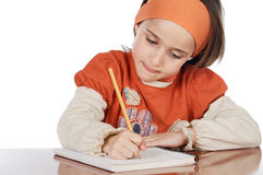 Adorable girl studying Royalty Free Stock Photography