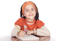 Adorable girl studying. In the school a over white background Royalty Free Stock Photos