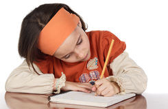 Adorable girl studying. In the school a over white background Royalty Free Stock Photo