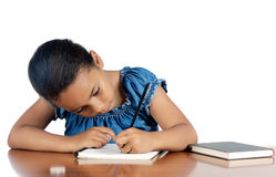 Adorable girl studying Royalty Free Stock Image