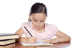 Adorable girl studying Stock Image