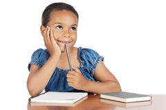 Adorable girl studying. In the school a over white background Royalty Free Stock Photography