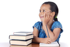 Adorable girl studying. In the school a over white background Stock Photography
