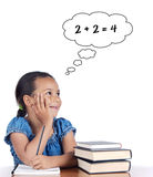Adorable girl studying mathematics Royalty Free Stock Photos