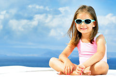 Adorable girl on sunbed. Adorable toddler girl relaxing on sunbed Royalty Free Stock Images