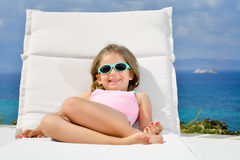 Adorable girl on sunbed Stock Image