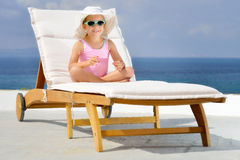 Adorable girl on sunbed Royalty Free Stock Photos