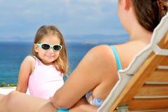 Adorable girl on sunbed Stock Photos