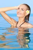 Adorable girl in the swiming pool Royalty Free Stock Image