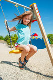 Adorable girl on a swing Royalty Free Stock Image