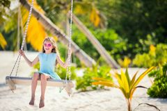 Adorable girl swinging Stock Photos