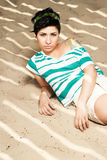 Adorable girl with tattoo on the beach Royalty Free Stock Image