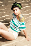 Adorable girl with tattoo on the beach Stock Photos