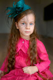 Adorable girl in turquoise hat Stock Image