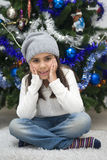 Adorable girl waiting for Santa Stock Images