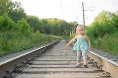 Adorable girl walk along rails Royalty Free Stock Photos