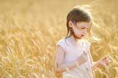 Adorable girl walking happily in wheat field Royalty Free Stock Images