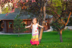 Adorable girl walking on the natural background Royalty Free Stock Images