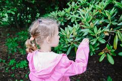 Adorable girl in spring park stock images