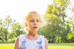 Adorable girl in spring park stock photography