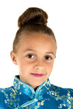 Adorable girl wearing a Chinese dress with hair in a bun Royalty Free Stock Photo
