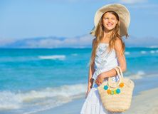 Adorable girl wearing elegant hat on the beach Royalty Free Stock Photography