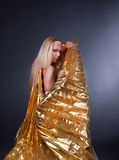 Adorable girl wearing a gold cloak Royalty Free Stock Photo