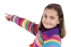 Adorable girl with woollen jacket pointing. On a over white background Stock Photo