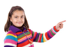 Adorable girl with woollen jacket pointing. On a over white background Stock Photos