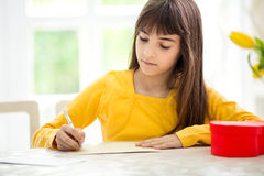 Adorable girl writing  greeting card Stock Photography