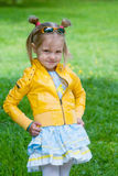 Adorable girl in yellow jacket Royalty Free Stock Photography