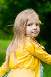 Adorable girl in yellow jacket Stock Images