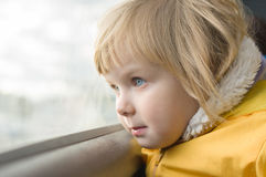 Adorable girl in yellow jacket ride on bus Stock Photography