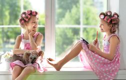 Adorable girls with dog Stock Photo