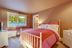 Adorable girls room with pink walls and red bedding. Stock Image