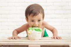 Adorable handsome toddler eating sponge cake Royalty Free Stock Images