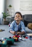 adorable happy african-american boy with toy tools royalty free stock images