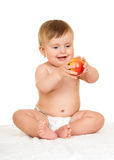 Adorable happy baby with apple Stock Photography